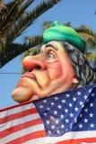 Muammar Gaddafi achter de Amerikaanse Vlag Royalty-vrije Stock Afbeelding