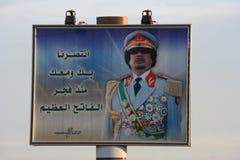 Muammar Gaddafi en la cartelera enorme Imagen de archivo