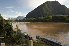 Muang Ngoi village on Nam Ou River at dusk. Picturesque river views and genuine local color of northern Laos Royalty Free Stock Photography