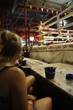 Muay Thai boxing. People watching traditional Muay Thai boxing in a bar of Thailand Stock Photos