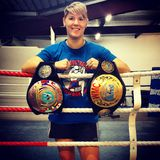 Muay thai Champ. Muay Thai world champion Kate Boyd with 2 of her belts Stock Photos
