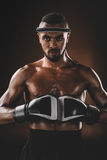 Muay Thai fighter with boxing gloves looking at camera, boxing gloves fight concept Stock Photo