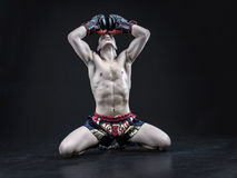 Muay thai fighter isolated on black background. Muscular caucasian muay thai fighter isolated on black background stock images