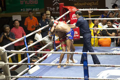 Muay Thai fighters compete in a Thai boxing match Stock Image
