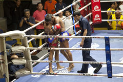 Muay Thai fighters compete in a Thai boxing match Royalty Free Stock Photos