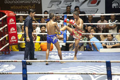 Muay Thai fighters compete in a Thai boxing match Royalty Free Stock Image