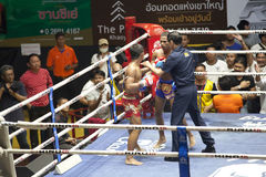 Muay Thai fighters compete in a Thai boxing match Stock Images