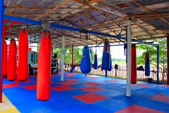 Free Muay Thai Gym With Boxing Bags And Colorful Rubber Floor At Ban Bung Sam Phan Nok, Phetchabun, Thailand. Stock Photo - 129054630