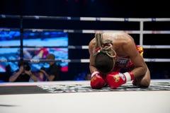 Muay Thai Way Kru. BANGKOK - JUNE 9: Muay Thai Super Lightweight World Championship - Jomtong Chuwattana (Thailand) praying ritual before the fight at BATTLE FOR stock image