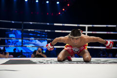 Muay Thai Way Kru. BANGKOK - JUNE 9: Muay Thai Super Lightweight World Championship - Jomtong Chuwattana (Thailand) praying ritual before the fight at BATTLE FOR royalty free stock photo
