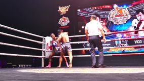 Muaythai Day (Thai boxing). BANGKOK -FEBRUARY 6: Pechsiam K. with Vigo H. in Krudam Fight #4 on Muaythai Day (Thai boxing) at Asia Tique on February 6, 2016 in stock video footage