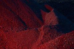Mucchi della luce del carbone in rosso Immagine Stock