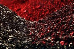 Mucchi della luce del carbone in rosso Fotografia Stock
