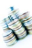 Mucchi delle monete Fotografia Stock