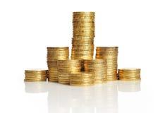 Mucchi delle monete di oro Fotografie Stock
