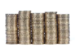 Mucchi delle monete, isolati su bianco Fotografie Stock Libere da Diritti