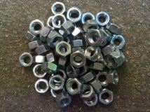 Mucchio dei dadi del metallo Fotografie Stock