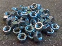 Mucchio dei dadi del metallo Fotografie Stock Libere da Diritti