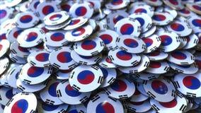 Mucchio dei distintivi che caratterizzano le bandiere della Corea del Sud rappresentazione 3d Immagine Stock
