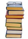 Mucchio dei libri e dei vetri Fotografia Stock Libera da Diritti