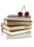 Mucchio dei libri e di due ciliegie. Immagini Stock Libere da Diritti