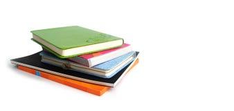 Mucchio dei libri e dei taccuini Immagini Stock