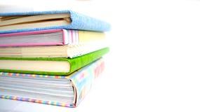 Mucchio dei libri e dei taccuini Immagine Stock