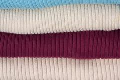 Mucchio dei maglioni lavorati a maglia Fotografie Stock