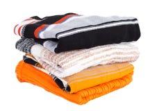 Mucchio dei maglioni multi-colored Fotografia Stock
