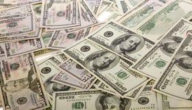 Mucchio dei soldi di valuta $100, $50 fatture degli Stati Uniti del dollaro Fotografia Stock Libera da Diritti