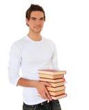 Mucchio della holding dell'allievo dei libri Fotografia Stock