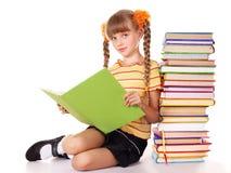 Mucchio della holding della scolara dei libri. Immagine Stock