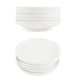 Mucchio della pila dei piatti ceramici bianchi del piatto Fotografie Stock