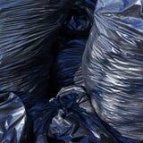 Mucchio delle borse di immondizia piene Immagini Stock