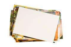 Mucchio delle fotografie con il blocco per grafici vuoto Immagine Stock