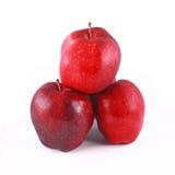 mucchio delle mele rosse isolate su bianco Fotografia Stock