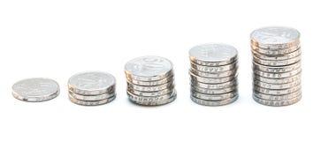 Mucchio delle monete che salgono Fotografia Stock