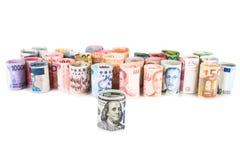 Mucchio delle note acciambellate di valuta con il dollaro americano nella parte anteriore Fotografia Stock Libera da Diritti