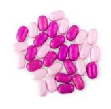 Mucchio delle pillole multicolori su fondo bianco Immagini Stock