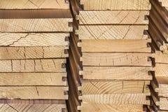 Mucchio delle plance di Decking di White Pine - vista laterale Immagini Stock