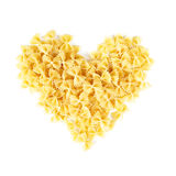 Mucchio di forma del cuore di Farfalle o della pasta del farfallino Fotografia Stock