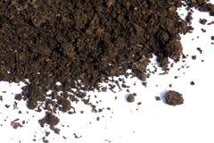 Mucchio di suolo isolato su fondo bianco fotografie stock
