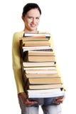 Mucchio infelice della holding della scolara dei libri. Fotografie Stock Libere da Diritti