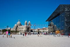 MuCem Marseille. Visitors walk in front of the Museum of European and Mediterranean Civilizations (MuCEM) in Marseille on July 29, 2013. MuCEM has opened its Royalty Free Stock Photos