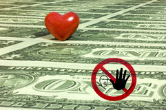 Much money. A red heart and a no entry sign on a sea of one dollar bills. With space for copy royalty free stock photography