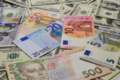 Much money. Many banknotes. Dollar, euro and hryvnia stock images