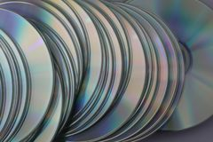 Much silver compact discs scattered on flatness royalty free stock photography