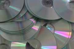 Much silver compact discs scattered on flatness. Much scattered silver compact discs stock photo