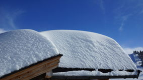 Much snow on the roofs of the houses Stock Photography