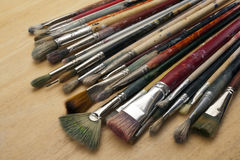 Much used art paint brushes Stock Photos